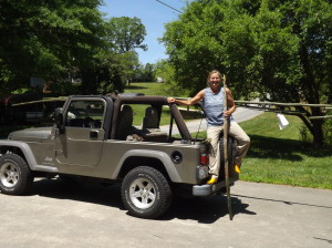Kim with her Jeep, packed full of bamboo