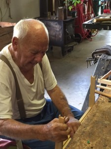 84-year-old beekeeper, Tate Poarch, constructs a brood frame in his shop.